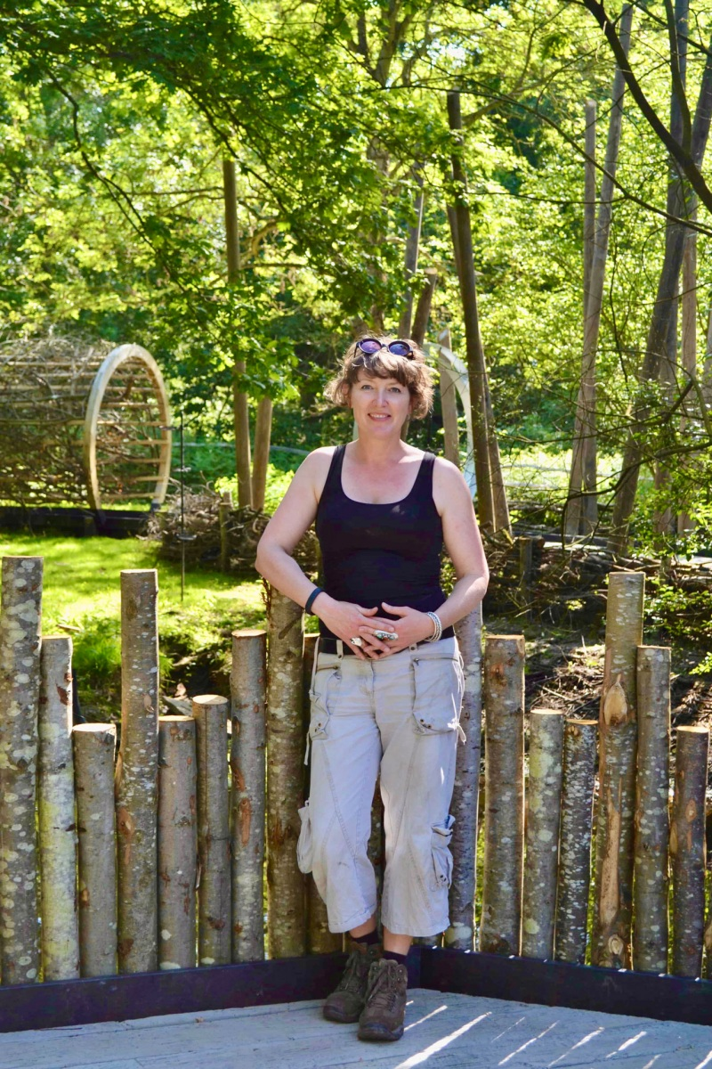 Garden and Landscape designer Ann-Marie Powell in the woodland hospice garden she designed for Greenfinger's Charity