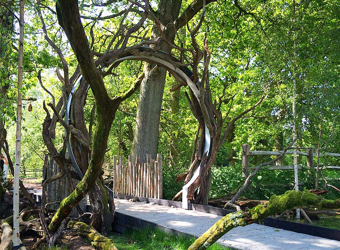 Rustic timber moongate arch at entrance to children's hospice woodland garden designed by AMPG