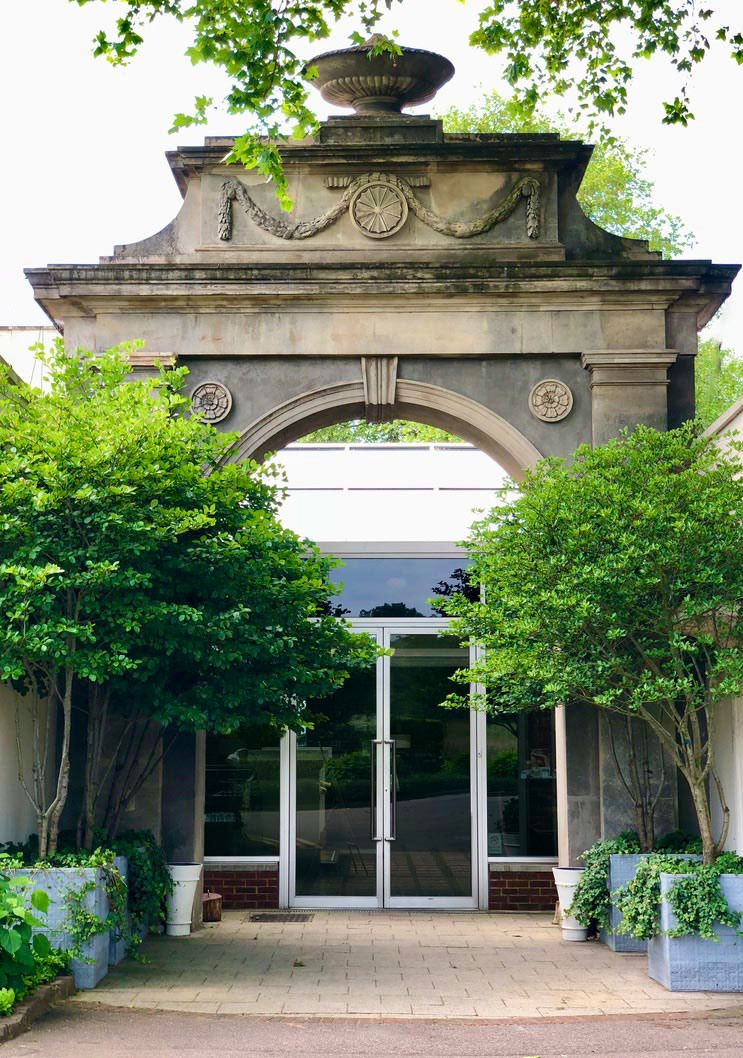 Grand archway entrance framed by four multistem hawthorn trees in lead planters with trailing ivy designed by AMPG