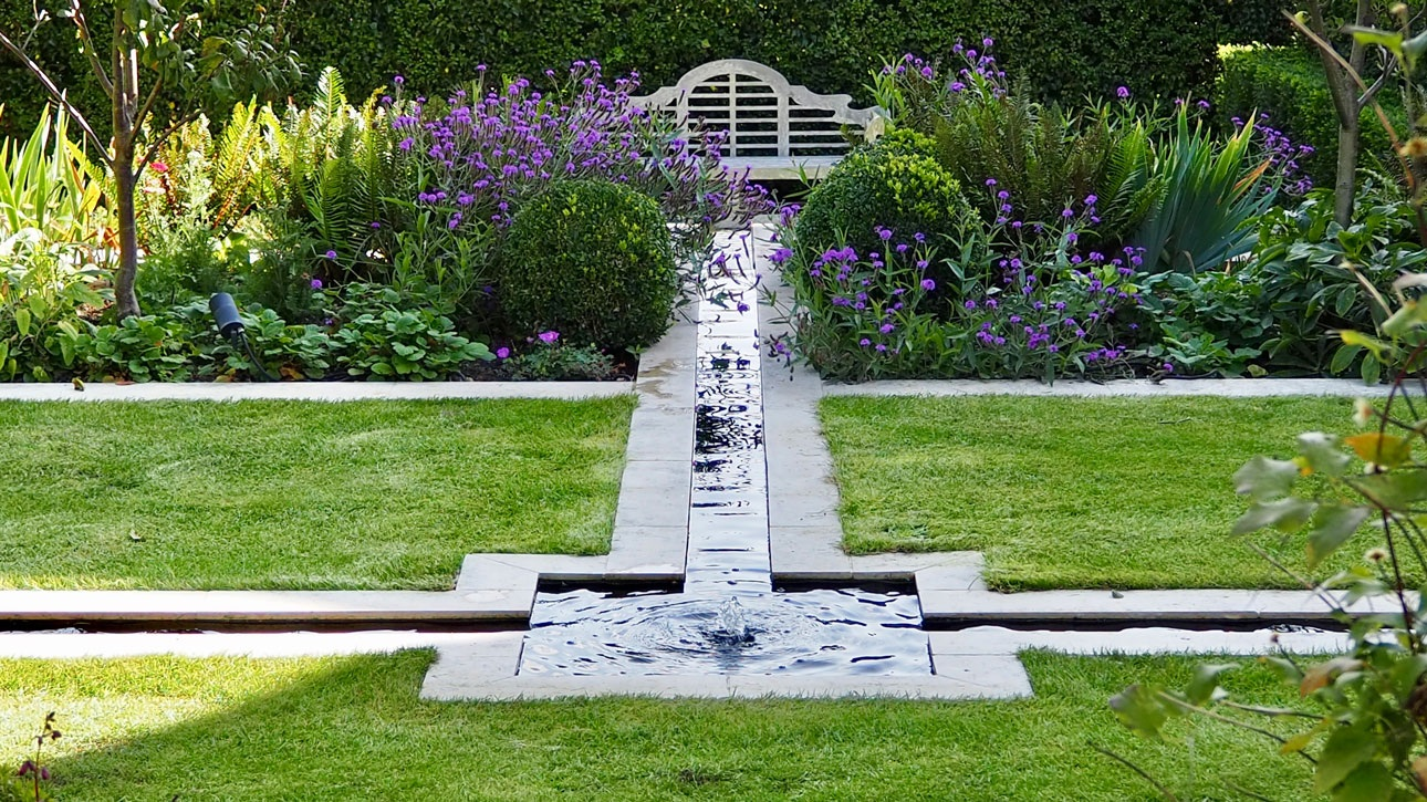 Water garden with rill water channel square bubble fountain, leading to lutyens bench and mixed planting, designed by AMPG