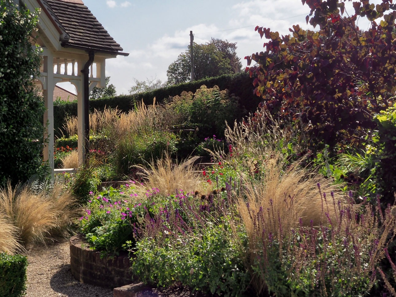 Energetic planting design for steeply sloping front garden in Berkshire designed by landscape designer Ann-Marie Powell