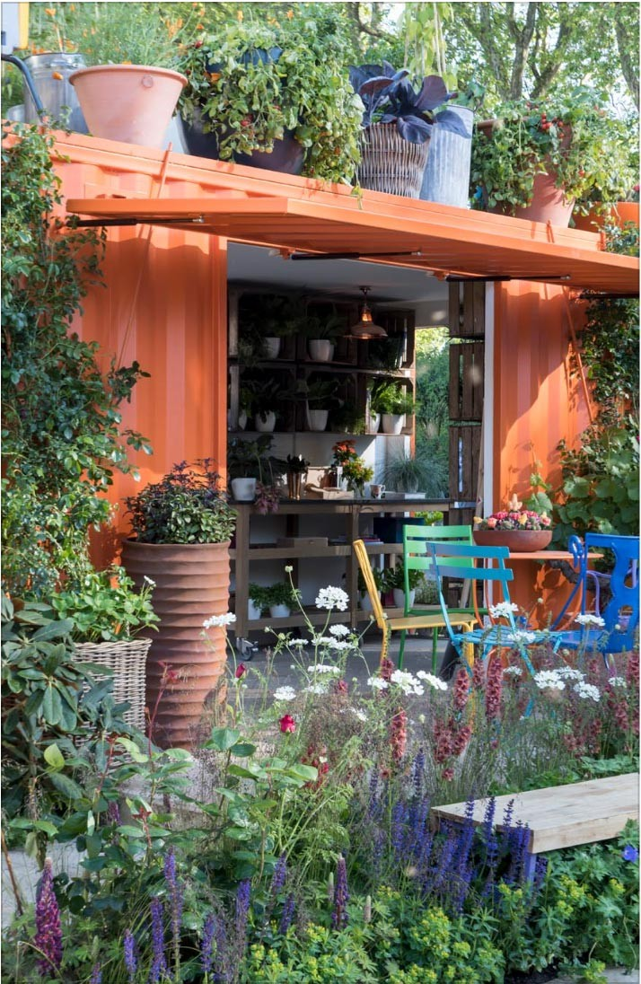 Ann-Marie Powell's garden design at RHS Chelsea 2016 with containers plants and vegetables and colourful garden furniture.