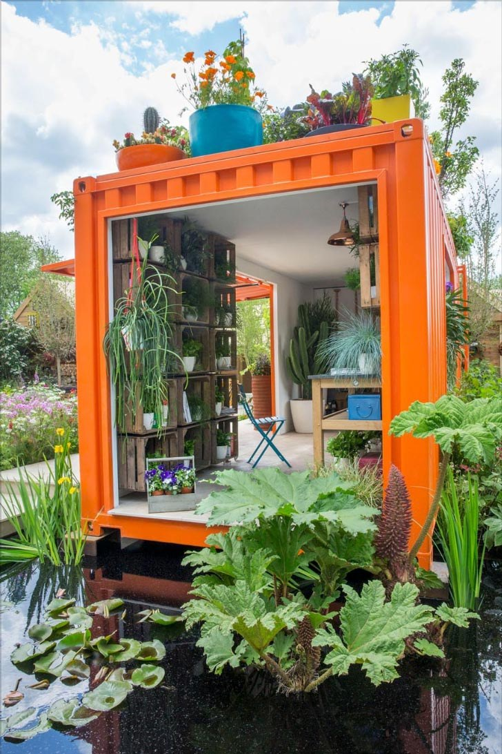 Orange shipping container potting shed with contemporary garden pond, RHS Chelsea by Ann-Marie Powell Gardens, Hampshire.