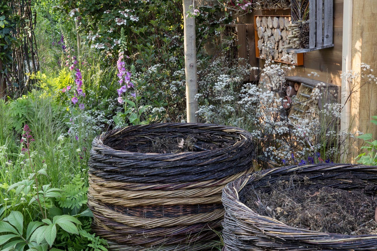 Bespoke compost bins woven from willow and copper on RHS Chelsea garden 2016 designed by Ann-Marie Powell Gardens, Hampshire.