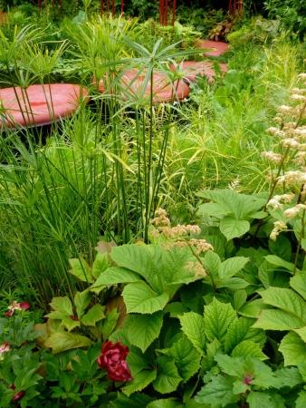 Green planting alongside resin structures