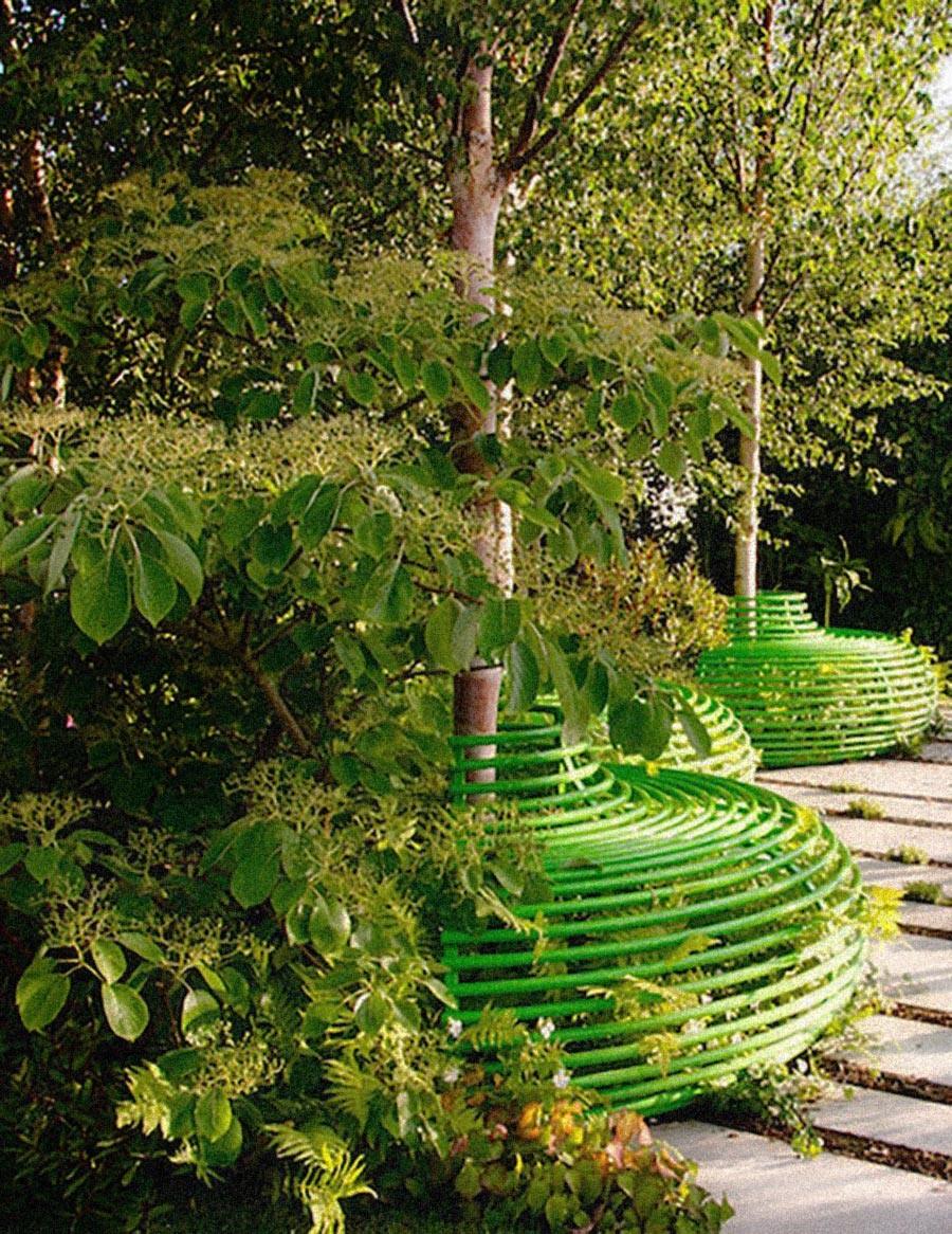 Contemporary green steel tree seats with Betula albosinensis at RHS Hampton Court by garden designer Ann-Marie Powell