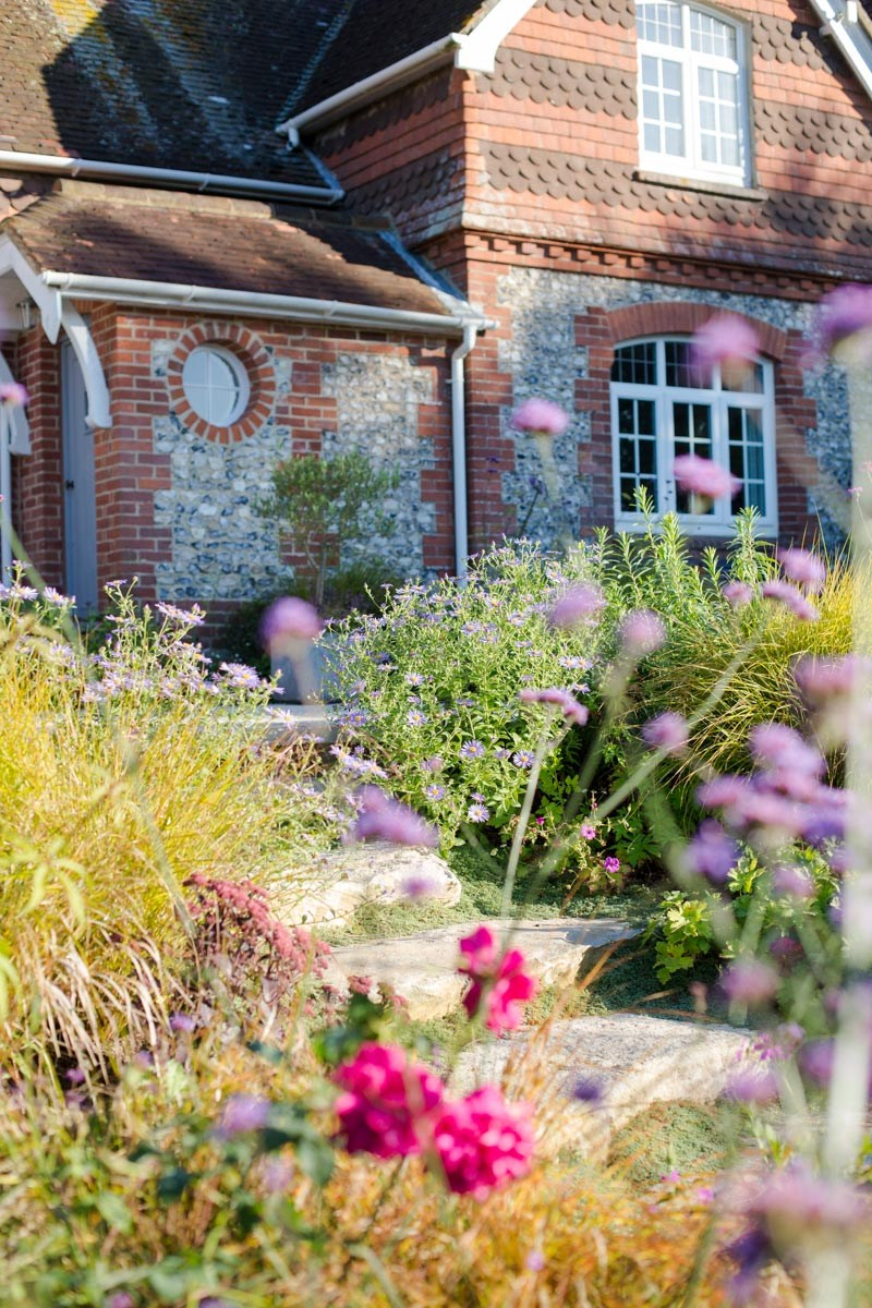 West Sussex cottage with rural refined contemporary cottage planting with Verbena by Purbeck stone steps by Ann-Marie Powell.