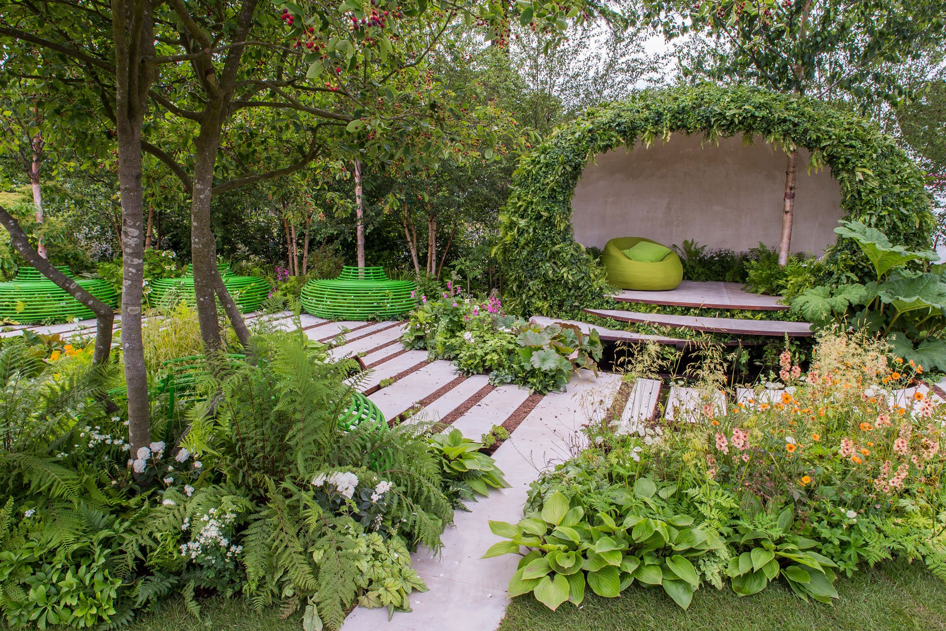 A natural garden building, wildlife planting, urban pond, contemporary tree seats at RHS Hampton Court 2015; Macmillan Garden