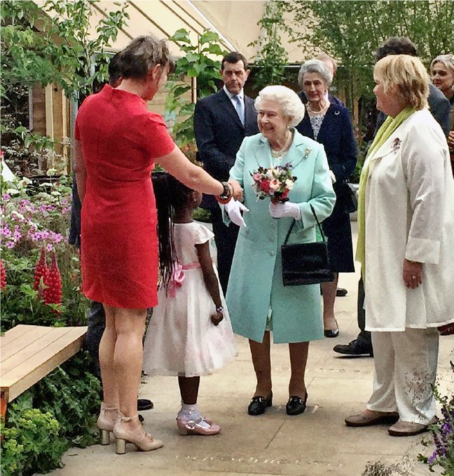 Garden designer Ann-Marie Powell introduced to Her Majesty The Queen at RHS Chelsea 2016 with Director General Sue Biggs.