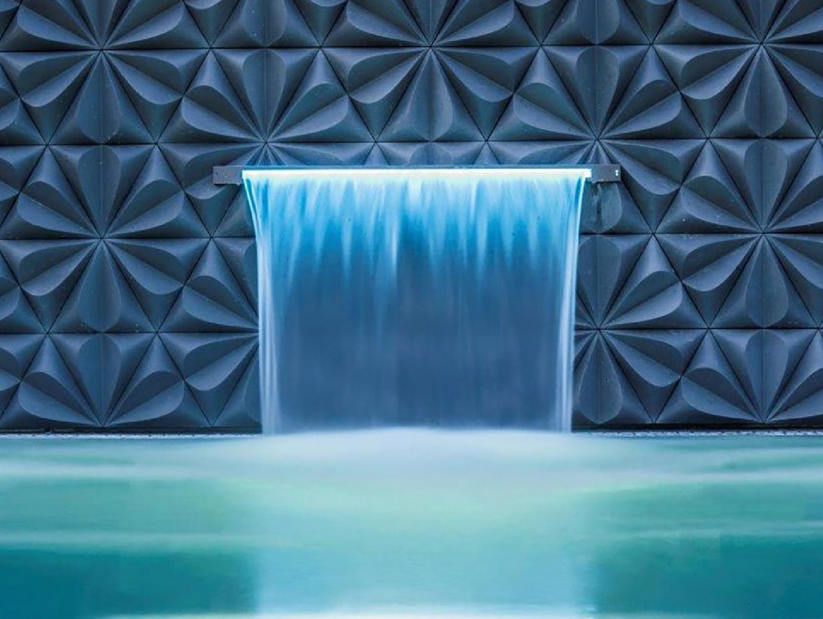 Water blade detail into luxury spa pool in Ann-Marie Powell Gardens design