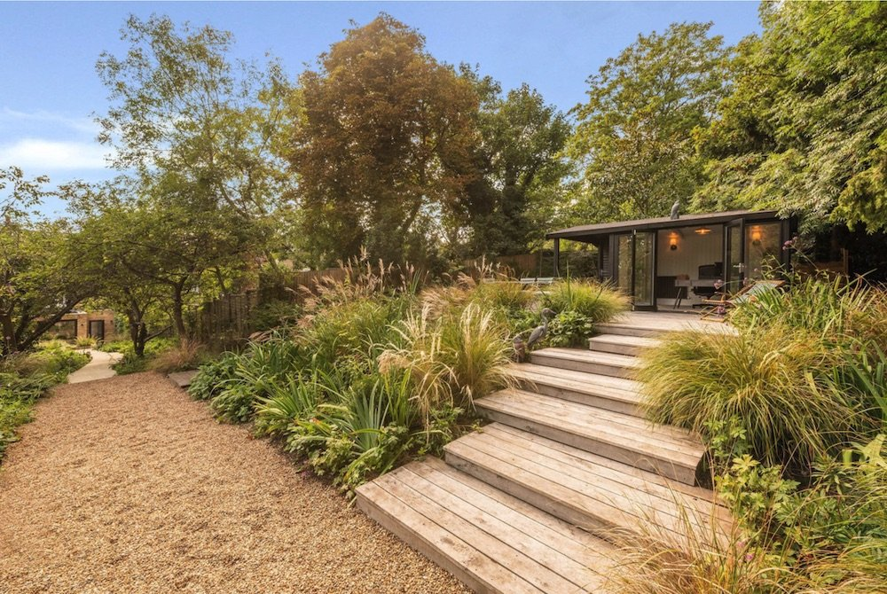 Grasses, perennials and deck steps in West Kensington, London garden designed by Petersfield based Ann-Marie Powell Gardens
