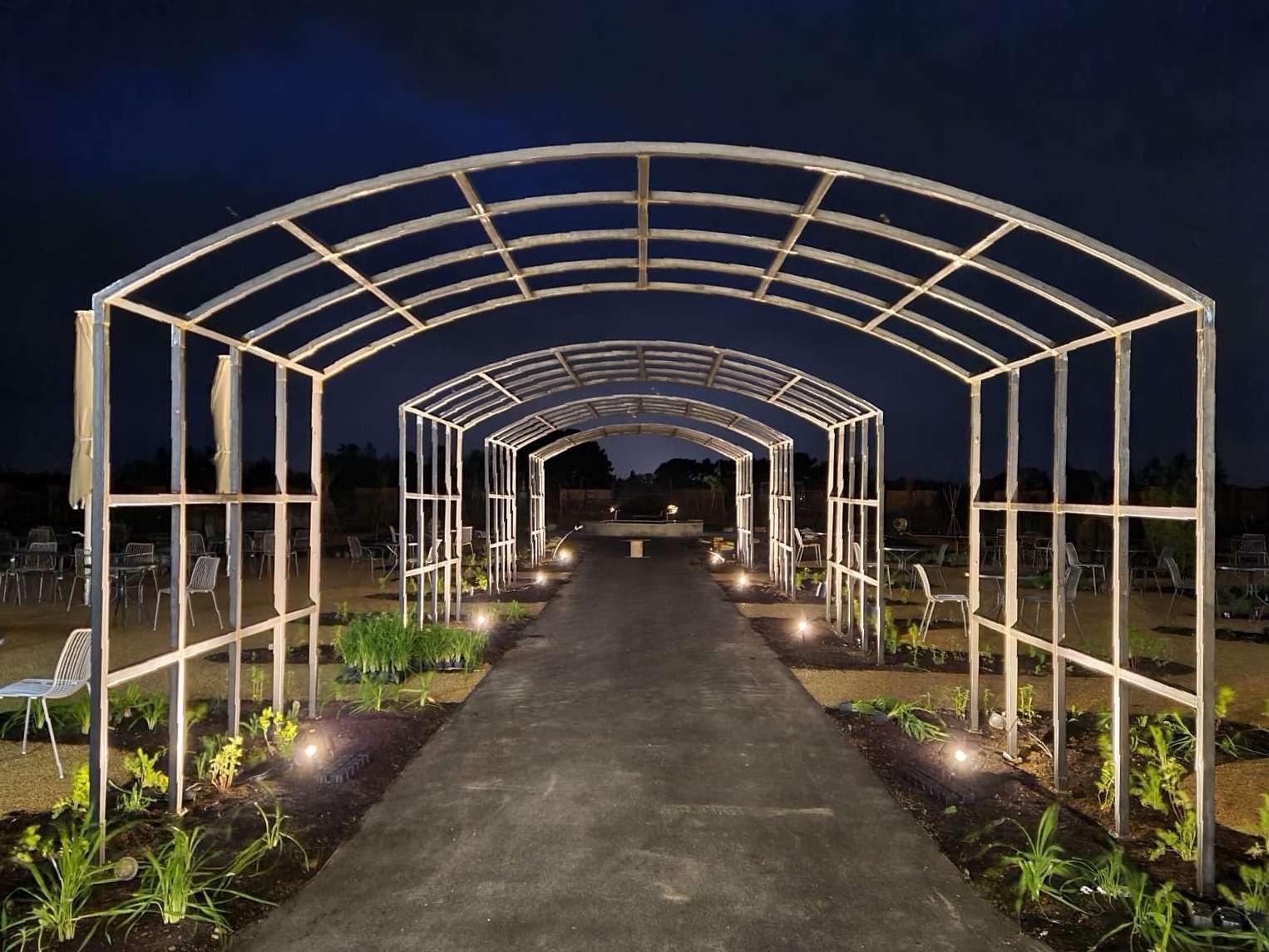 Arches at night at Royal Horticultural Society Wisley
